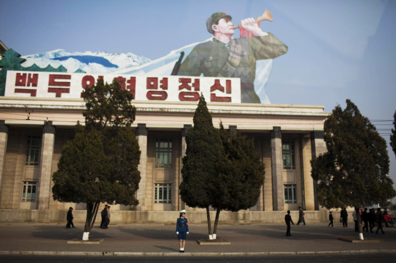In this April 15, 2011 photo taken through a bus window, a North Korean traffic police woman stands on the side of the street in Pyongyang, North Korea. (AP Photo/David Guttenfelder)