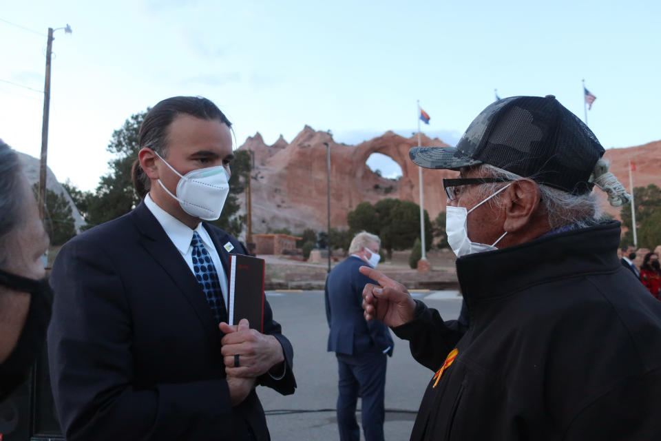 Bryan Newland, left, speaks with Navajo Nation Council Delegate Daniel Tso on Thursday, April 22, 2021 in Window Rock, Ariz. Biden nominated Newland on Thursday to be assistant secretary for Indian Affairs in the Interior Department. (AP Photo/Felicia Fonseca)