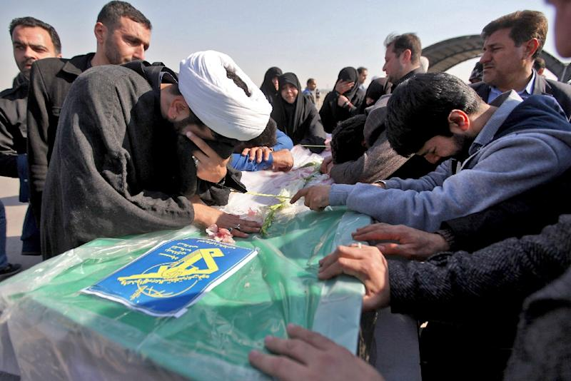 Iranians mourn victims of a suicide bombing on a Revolutionary Guards bus in southeastern Iran, as the coffins arrive at Badr airport in Isfahan, some 400 kilometres south of the capital Tehran on February 14, 2019