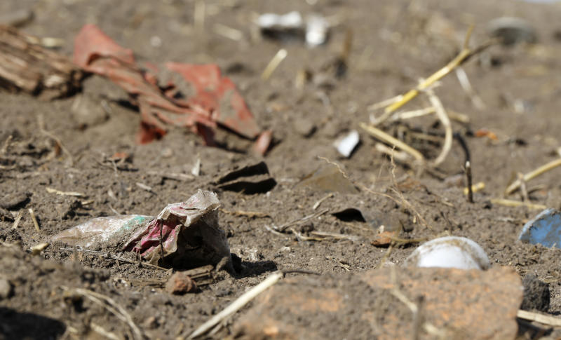 In this Sept. 9, 2018 photo plastic waste sits on a freshly cultivated field in Nauen, Germany. Scientists in Austria say they've detected tiny bits of plastic in people's stool for the first time, but experts caution the study is too small and premature to draw any credible conclusion. (AP Photo/Ferdinand Ostrop)