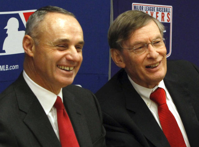 Major League Baseball commissioner Bud Selig, right, and MLB Vice President of Labor Relations Rob Manfred, react during a news conference announcing a five-year collective bargaining agreement, Tuesday, Nov. 22, 2011 in New York. (AP Photo/Bebeto Matthews)