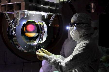 A Laser Interferometer Gravitational-wave Observatory (LIGO) technician performs a Large optic inspection in this undated photo released by Caltech/MIT/LIGO Laboratory on February 8, 2016. REUTERS/Caltech/MIT/LIGO Laboratory/Handout via Reuters