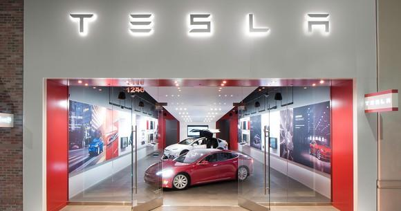 The front entrance and facade of a Tesla retail store in a mall.