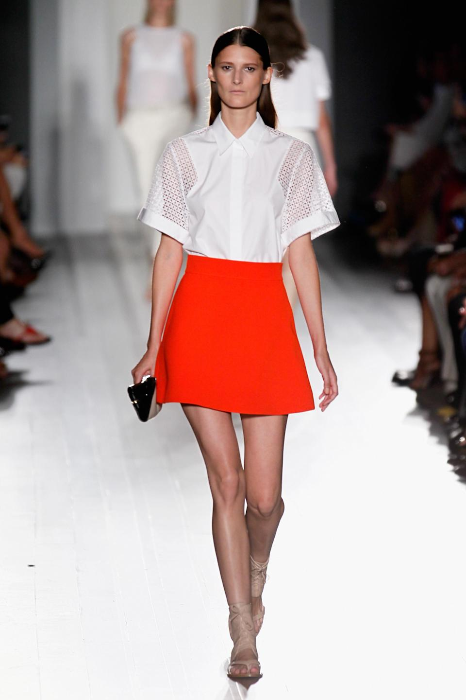 <p>For SS13, Victoria Beckham eschewed her famed love of the heel in favour of pastel-hued gladiator sandals and buckled loafers. Boxy shirts were tucked into primary red skirts and a miniscule wallet was all we needed. <em>[Photo: Getty] </em> </p>