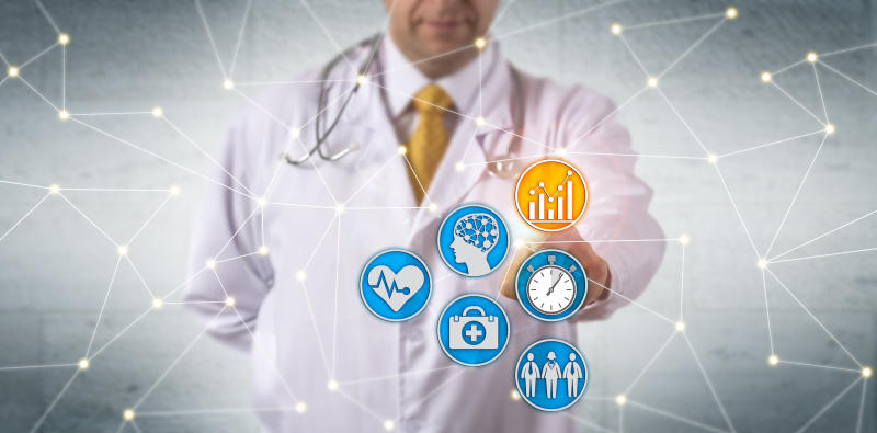A doctor stands behind connected symbols representing several forms of healthcare data