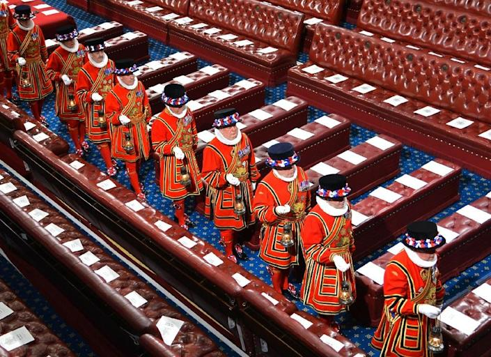 Yeomen of the Guard march through the House of Lords before the State Opening of Parliament on May 8, 2013 (AFP Photo/Toby Melville)