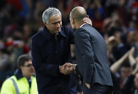 Football Soccer Britain - Manchester United v Manchester City - EFL Cup Fourth Round - Old Trafford - 26/10/16 Manchester United manager Jose Mourinho with Manchester City manager Pep Guardiola after the match Action Images via Reuters / Jason Cairnduff Livepic