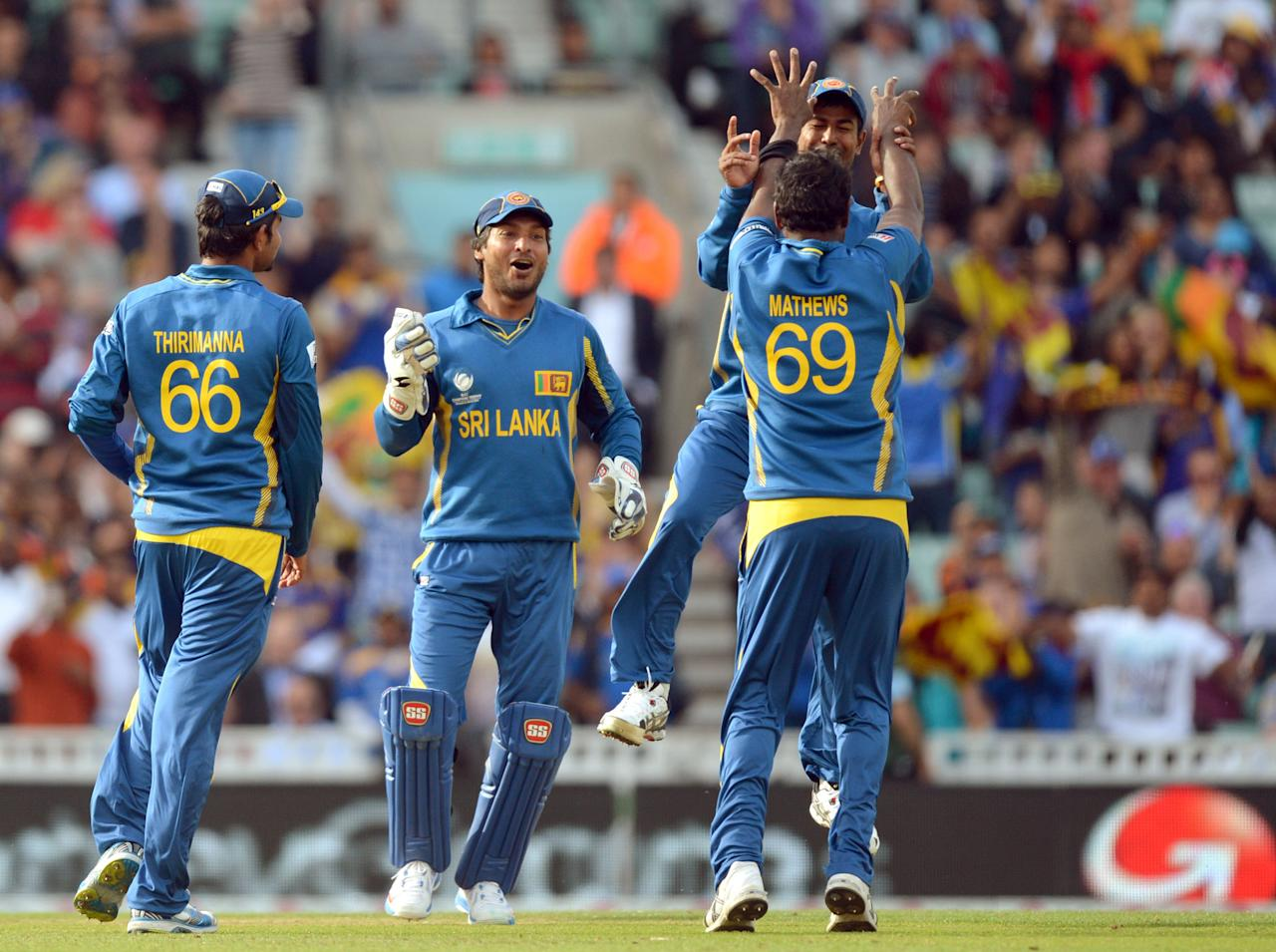 Sri Lanka's captain Angelo Matthews (right) celebrates bowling out Australia's Mitchell Marsh (not pictured) during the ICC Champions Trophy match at The Oval, London.