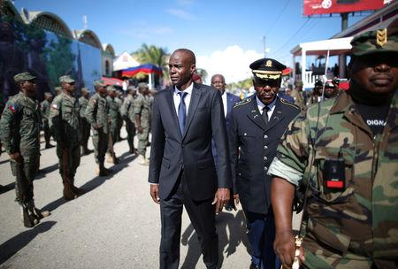 Haitian President Jovenel Moise (C) and acting Chief of the army's high command Jodel Lesage inspect the troops before a parade of the Haitian Armed Forces (FAD'H) in the streets of Cap-Haitien, Haiti, November 18, 2017. REUTERS/Andres Martinez Casares