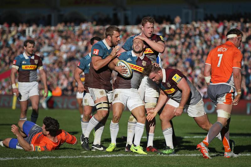 Danny Care is congratulated by his team-mates after his try: Getty Images for Harlequins