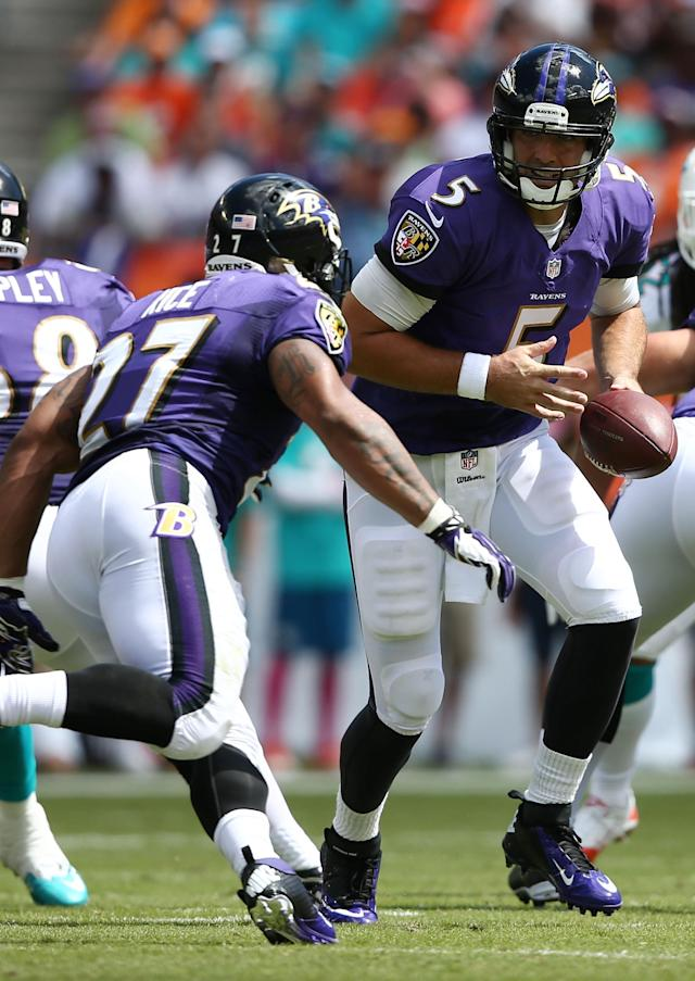 Baltimore Ravens quarterback Joe Flacco (5) looks to hand off to Ray Rice (27) during the first half of an NFL football game against the Miami Dolphins, Sunday, Oct. 6, 2013, in Miami Gardens, Fla. (AP Photo/J Pat Carter)