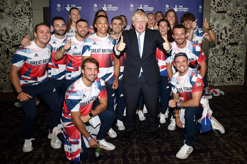 LONDON, ENGLAND - AUGUST 15: Prime Minister, Boris Johnson poses with Olympians during The National Lottery's Team GB homecoming event at Hilton London Wembley on August 15, 2021 in London, England. (Photo by Gareth Cattermole/Getty Images for The National Lottery)