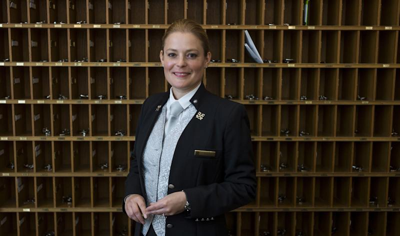 The only woman in Paris to hold the position of Chief Concierge in a luxury hotel, Sonia Papet stands in the Bristol Hotel, on June 30, 2014 (AFP Photo/Fred Dufour)