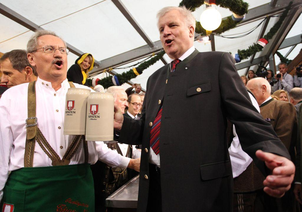 Munich mayor Christian Ude (L) and Bavarian state premier Horst Seehofer toast with the first barrels of beer to start the Oktoberfest 2012 beer festival.