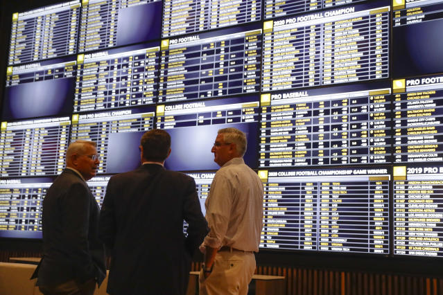 "Though several stadiums will be allowed to operate ""betting lounges"" this fall, actually placing bets at the stadiums will still be prohibited. (AP/Michael Conroy)"