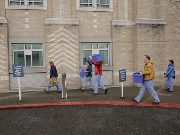 Harborview Medical Center's home assessment team carry protective and testing supplies while preparing to visit the home of a person potentially exposed to the coronavirus in Seattle, on February 29.