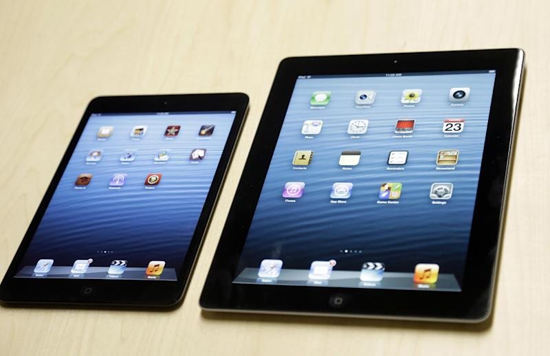 The iPad mini, at left, is shown next to the 4th generation iPad in San Jose, Calif., Tuesday, Oct.  23, 2012. The device has a screen that's about two-thirds the size of the full-size model, and Apple says it will cost $329 and up.  (AP Photo/Marcio Jose Sanchez)