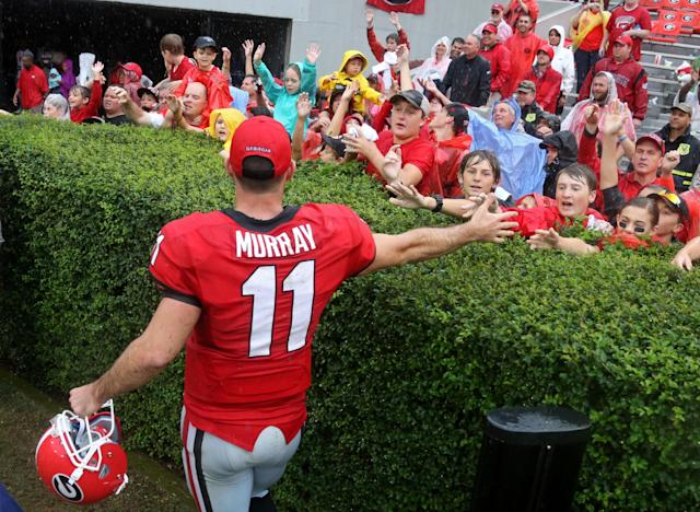 Georgia quarterback Aaron Murray greets fans after Georgia defeated North Texas 45-21 in an NCAA college football game at Sanford Stadium Saturday, Sept. 21, 2013, in Athens, Ga. (AP Photo/Atlanta Journal-Constitution, Jason Getz )