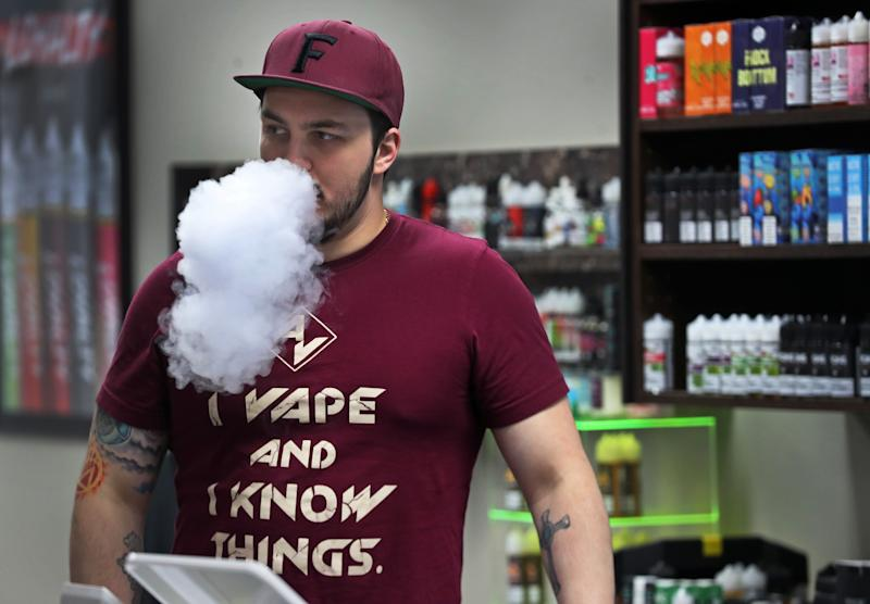 NASHUA, MA - NOVEMBER 26: Ken Irons, the general manager at Arcus Vapors, blows smoke in his Nashua, NH store on Nov. 26, 2019. Along the border in New Hampshire and Maine, sales of nicotine and cannabis vaping products boomed after Sept. 24, when Massachusetts Governor Charlie Baker banned both amid an outbreak of vaping-related lung injuries. At Arcus Vapors, sales of e-cigarette liquids and equipment have doubled. The ban was lifted on Dec. 11. (Photo by Jim Davis/The Boston Globe via Getty Images)