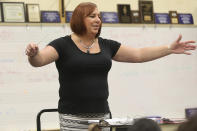 FILE - In this April 23, 2018 file photo, Stephanie Byers conducts a band class at Wichita North High School. Byers, a retired high school band teacher, expressed hope that her Nov. 3, 2020 victory in her race for the Kansas House of Representatives would encourage other transgender people in conservative Kansas. (Jaime Green//The Wichita Eagle via AP)