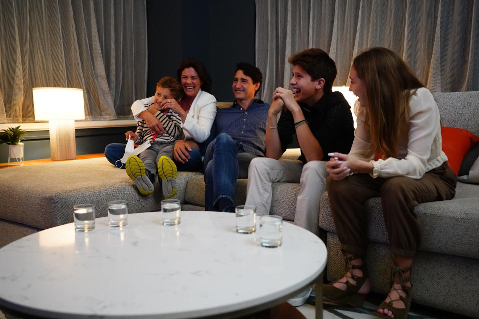 Justin Trudeau watches the 2021 election results with his family. - Credit: AP
