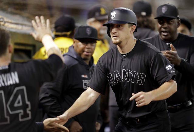 San Francisco Giants' Alex Dickerson, right, celebrates with Scooter Gennett (14) during the sixth inning of the team's baseball game against the Oakland Athletics on Saturday, Aug. 24, 2019, in Oakland, Calif. (AP Photo/Ben Margot)