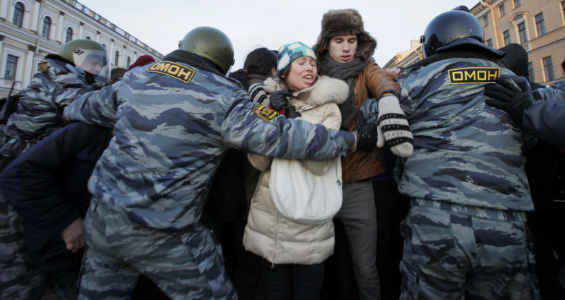 Russian police officers detain opposition activists during a protest against alleged vote rigging in St. Petersburg, Russia, Monday, March 5, 2012. More then 100 protesters were arrested in St. Petersburg, where some 2,000 gathered for an unauthorized rally to protest Prime Minister Vladimir Putin's victory in Russian presidential election. (AP Photo/Dmitry Lovetsky)