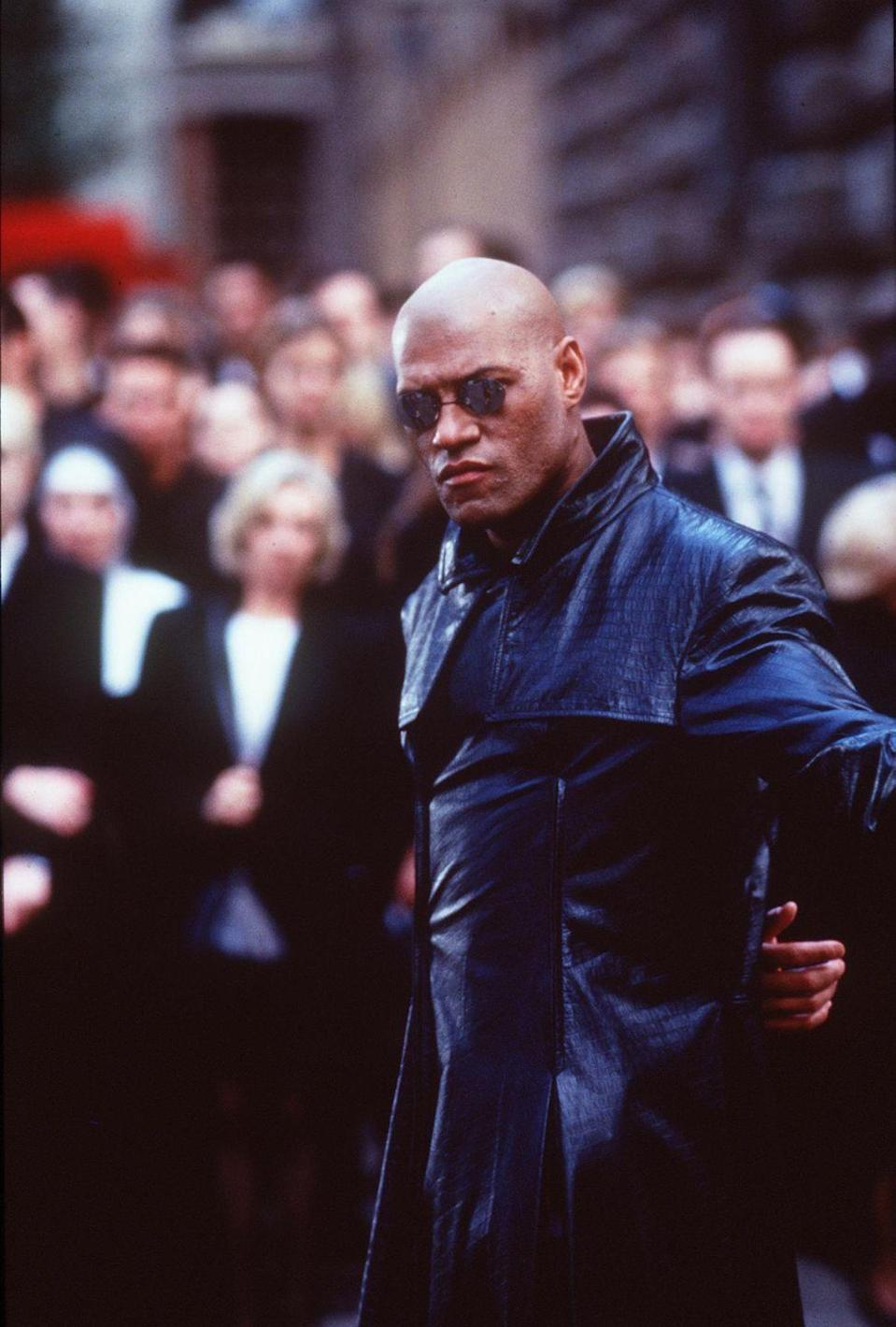 <p>A 1999 blockbuster movie, <em>The Matrix </em>is arguably what made the black trench coat so popular. So if you're looking for an easy costume for the office, you can't go wrong with a pair of round wire sunglasses and a full-length leather trench.</p>