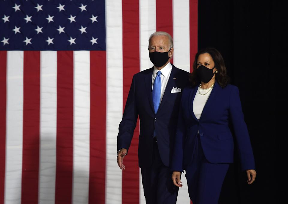 Democratic presidential nominee and former US Vice President Joe Biden (L) and vice presidential running mate, US Senator Kamala Harris, arrive to conduct their first press conference together in Wilmington, Delaware, on August 12, 2020. (Photo by Olivier DOULIERY / AFP)