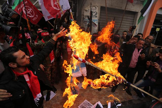 <p>Palestinian militants of the Popular Front for the Liberation of Palestine (PFLP) burn an Israeli flag and a U.S. flag during a protest against following Trump's decision to recognize Jerusalem as the capital of Israel, in Gaza City, Dec. 7, 2017. (Photo: APAImages/REX/Shutterstock) </p>