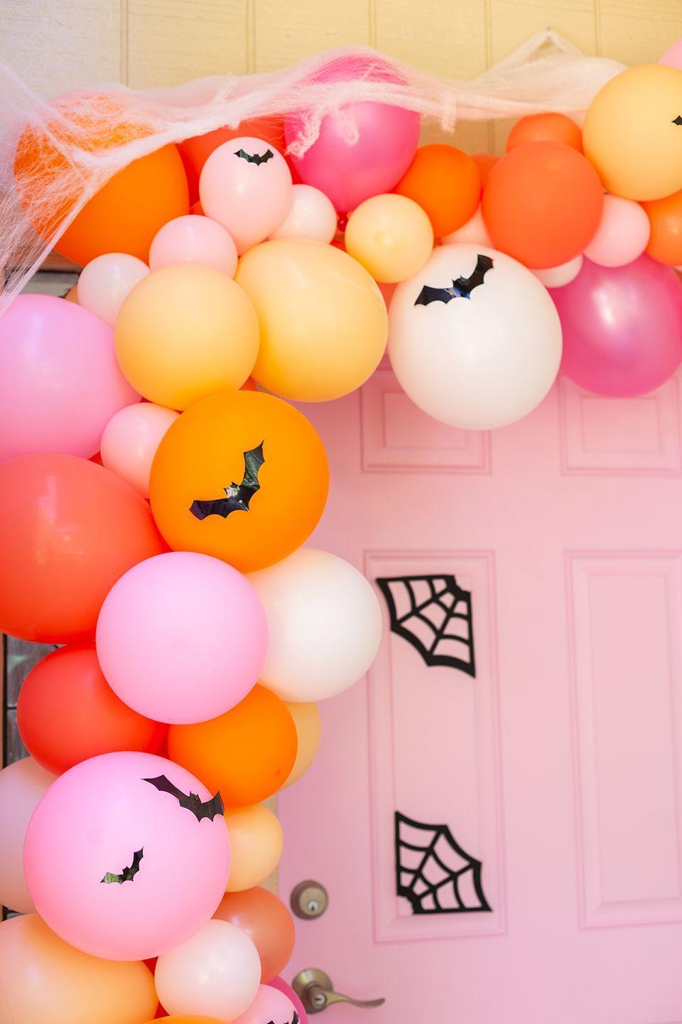 """<p>Your front door won't know what hit it! This brightly colored, out-of-the-box idea is a little more temporary than some of the other options on our list, but it's an excellent way to welcome guests to a one-night-only Halloween party.</p><p><strong>Get the tutorial at <a href=""""http://www.awwsam.com/2019/10/our-awwbode-halloween-door-decor.html"""" rel=""""nofollow noopener"""" target=""""_blank"""" data-ylk=""""slk:Aww Sam"""" class=""""link rapid-noclick-resp"""">Aww Sam</a>.</strong></p><p><a class=""""link rapid-noclick-resp"""" href=""""https://go.redirectingat.com?id=74968X1596630&url=https%3A%2F%2Fwww.walmart.com%2Fsearch%2F%3Fquery%3Dballoons&sref=https%3A%2F%2Fwww.thepioneerwoman.com%2Fholidays-celebrations%2Fg32894423%2Foutdoor-halloween-decorations%2F"""" rel=""""nofollow noopener"""" target=""""_blank"""" data-ylk=""""slk:SHOP BALLOONS"""">SHOP BALLOONS </a></p>"""