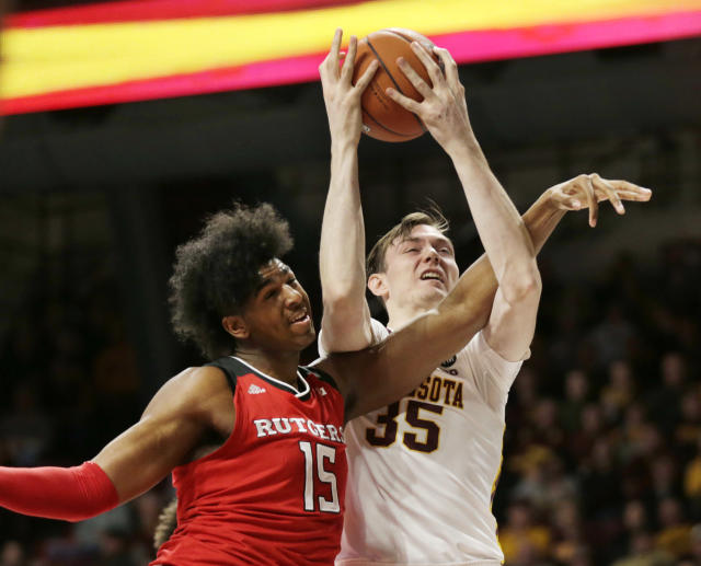 Minnesota center Matz Stockman (35) battles for a rebound with Rutgers center Myles Johnson (15) during the first half of an NCAA college basketball game Saturday, Jan. 12, 2019, in Minneapolis. (AP Photo/Andy Clayton-King)
