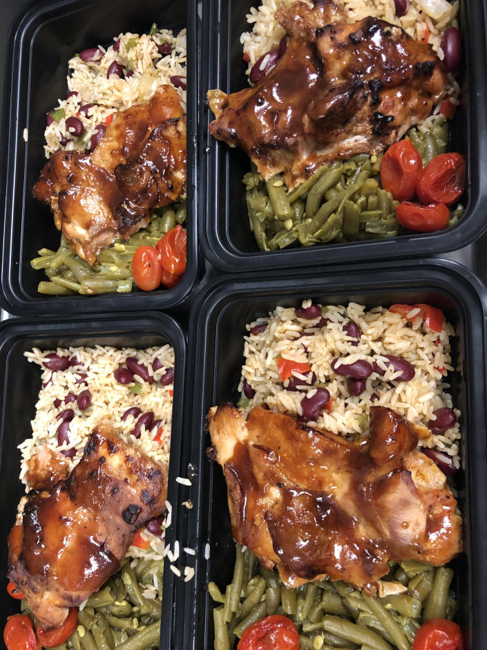 A typical Full Heart Full Bellies meal: barbecue chicken, Creole rice and beans and smothered green beans. (Courtesy of Millie Peartree)