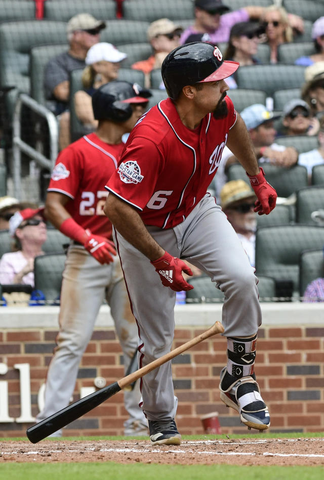 Washington Nationals' Anthony Rendon watches his line drive to left field for a double during the sixth inning of a baseball game against the Atlanta Braves, Saturday, Sept. 15, 2018, in Atlanta. Adam Eaton and Trea Turner scored on the play. (AP Photo/John Amis)