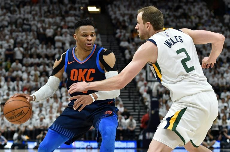 Russell Westbrook of the Oklahoma City Thunder tries to drive past the defense of Joe Ingles of the Utah Jazz as Utah moved to within one win of clinching their series with a convincing 113-96 win