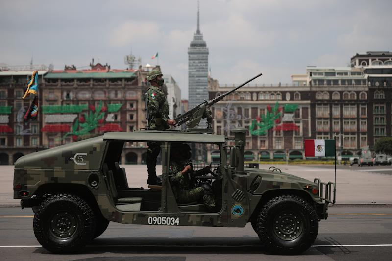 VARIOUS CITIES, MEXICO - SEPTEMBER 16: Soldiers look up towards President Andrés Manuel López Obrador during the Independence Day military parade at Zocalo Square on September 16, 2020 in Various Cities, Mexico. This year El Zocalo remains closed for general public due to coronavirus restrictions. Every September 16 Mexico celebrates the beginning of the revolution uprising of 1810. (Photo by Hector Vivas/Getty Images)