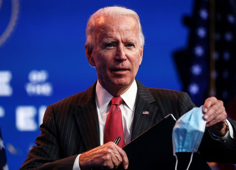 U.S. President-elect Joe Biden concludes his remarks to reporters following an online meeting with members of the National Governors Association (NGA) executive committee in Wilmington