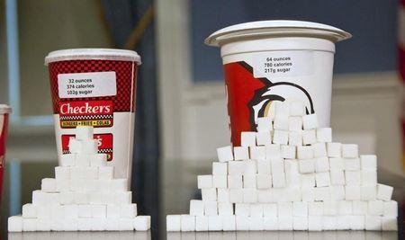 Soft drink cups sized at 32 ounces and 64 ounces are displayed at a news conference at City Hall in New York