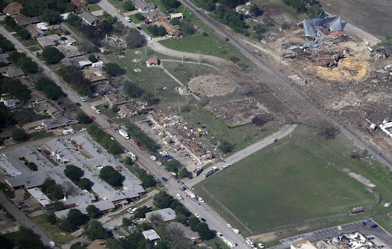 FILE - This Thursday, April 18, 2013 aerial photo shows the remains of a nursing home, left, apartment complex, center, and fertilizer plant, right, destroyed by an explosion in West, Texas.  There were no sprinklers. No firewalls. No water deluge systems. Safety inspections were rare at the fertilizer company in West, Texas, that exploded and killed at least 14 people this week.   (AP Photo/Tony Gutierrez, file)