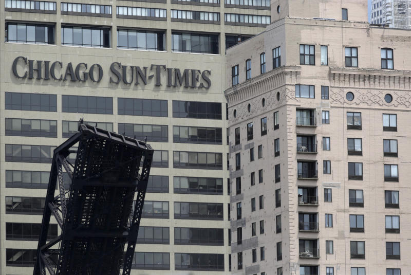 The Chicago Sun Times building is photographed Thursday, May 30, 2013, in Chicago. The Sun-Times Media announced today that they laid off their entire full time photography staff at the city's tabloid newspaper, and its suburban sister publications. The union representing laid-off photographers at the Chicago Sun-Times plans to file a bad-faith bargaining charge with the National Labor Relations Board. (AP Photo/M. Spencer Green)