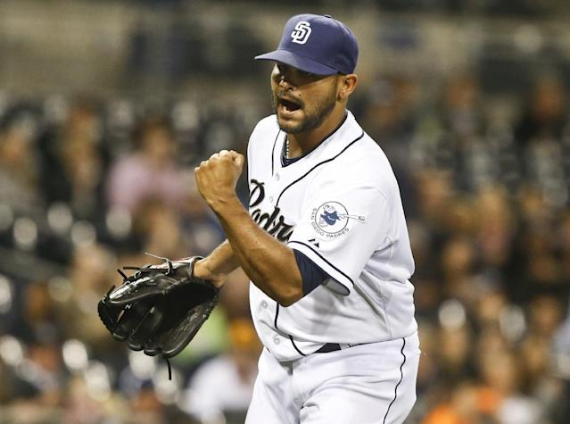 San Diego Padres relief pitcher Alex Torres pumps his fist after getting Colorado Rockies' Troy Tulowitzki to hit into an inning ending double play with two runners on base in the seventh inning of a baseball game Tuesday, April 15, 2014, in San Diego. (AP Photo/Lenny Ignelzi)