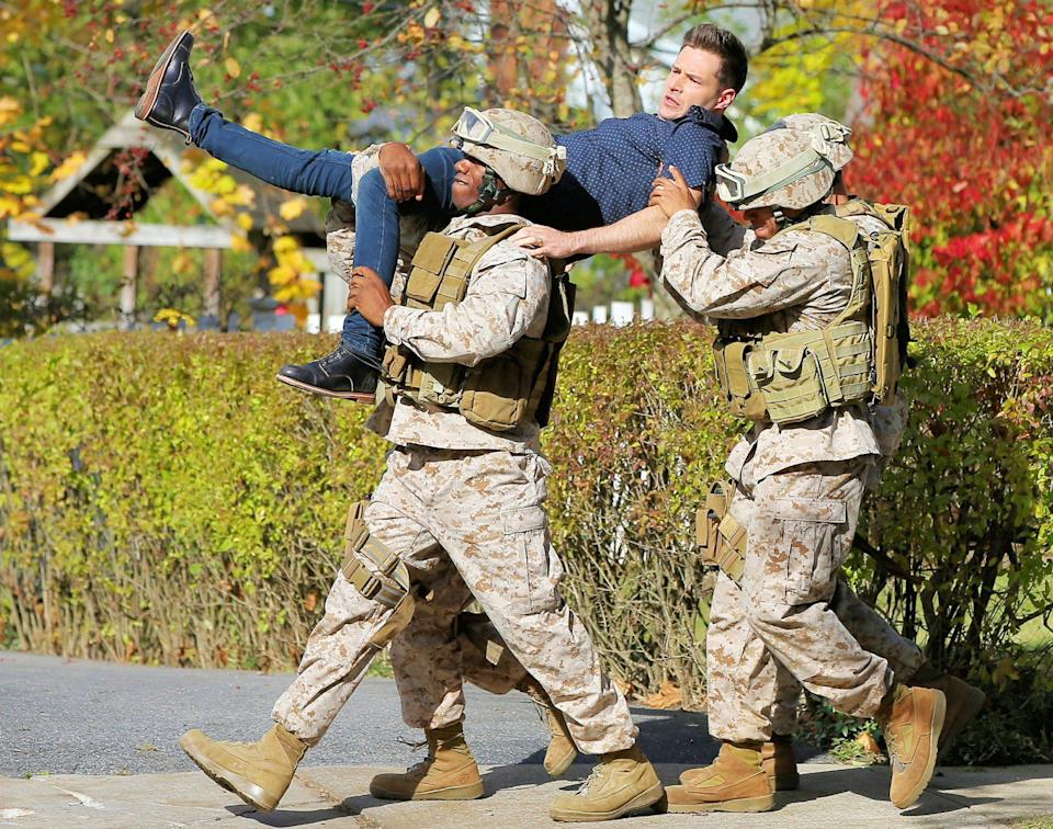 <p>Ben Rappaport gets carried away by Marines while filming <em>Modern Love</em> on Tuesday in Schenectady, New York.</p>