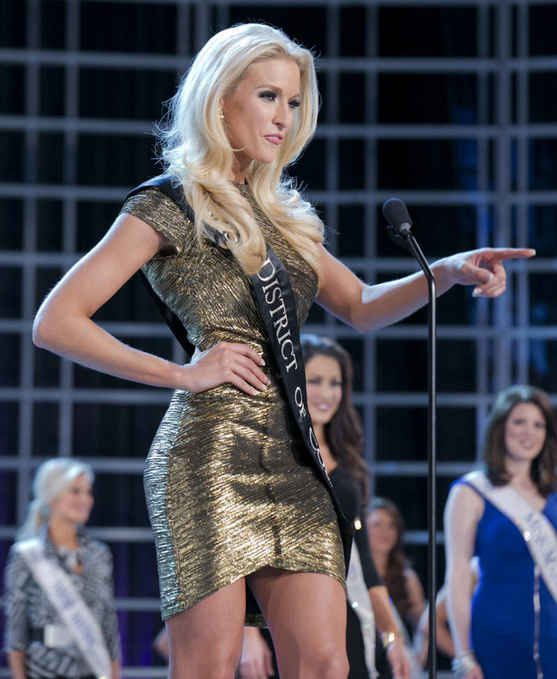 This photo courtesy Miss America Organization shows Miss DC, Allyn Rose, during preliminary competition at the 2013 Miss America Pageant in Las Vegas, Tuesday, Jan. 8, 2013.  Win or lose, Saturday's Miss America competition will be Rose's last pageant. The 24-year-old plans to undergo a double mastectomy after the event as a preventative measure to reduce her chances of developing the disease that killed her mother, grandmother and great aunt. (AP Photo/Courtesy Miss America Organization)