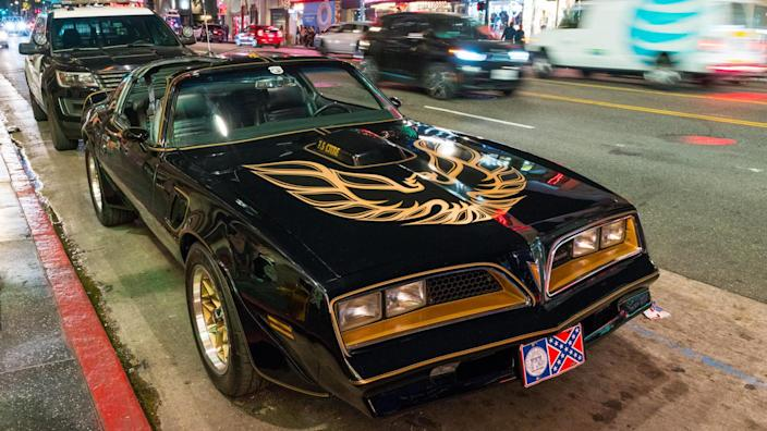 Mandatory Credit: Photo by Shutterstock (9871138f)A replica of the iconic Pontiac Trans-Am from 'Smokey and the Bandit', with a police car behind it, sits parked in front of Burt Reynolds' star on the Hollywood Walk of Fame, in honor of the celebrity after the announcement of his deathTributes to Burt Reynolds, Los Angeles, USA - 06 Sep 2018.