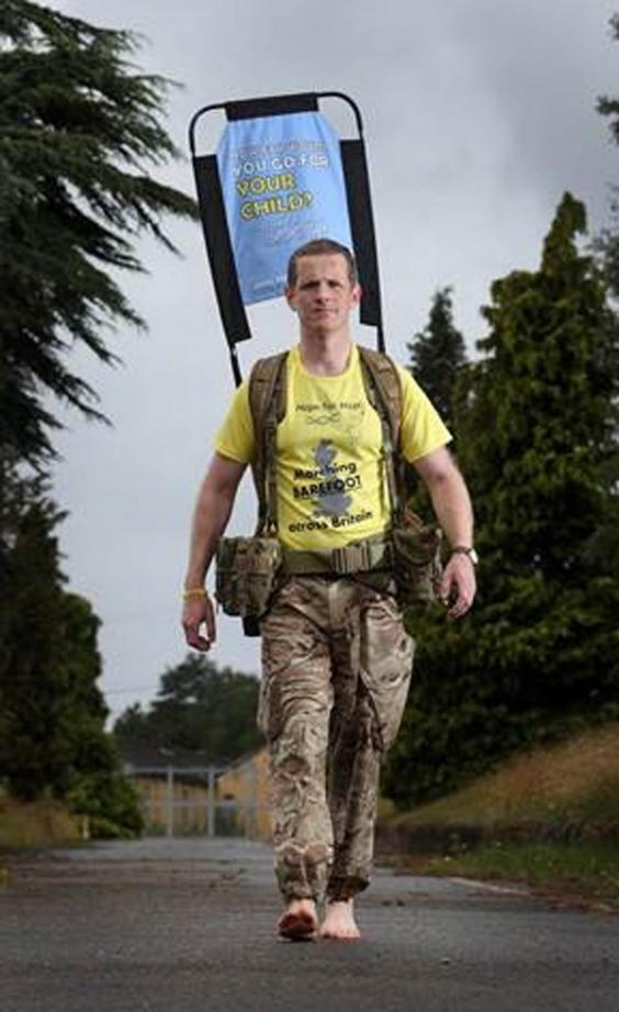 Major Christopher Brannigan is walking the length of the UK barefoot (PA)