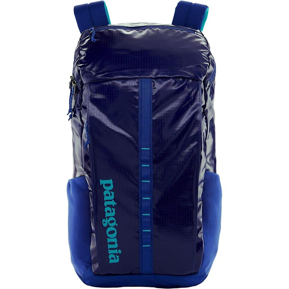 """<h2>Patagonia Black Hole Travel Pack</h2><br><strong>The Type: </strong>Backpack duffel<br><br><strong>The Hype:</strong> 4.8 out of 5 stars and 17 reviews on REI<br><br><strong>What Travelers Say: </strong>""""The capacity of this bag is outstanding, I am able to fit a week's worth of groceries inside when I need to and the weight is distributed quite excellently on the straps. Durability is also outstanding. I have scraped this bag on very sharp lava flow tunnels and fallen on it while snowboarding with little to no damage to the DWR coating. I have had this bag for three years now and don't forsee a need to replace this for a very long time. Great job Patagonia"""" – <em>Jacob, Patagonia Reviewer</em><br><br><em>Shop</em> <strong><em><a href=""""https://www.rei.com/b/patagonia"""" rel=""""nofollow noopener"""" target=""""_blank"""" data-ylk=""""slk:Patagonia"""" class=""""link rapid-noclick-resp"""">Patagonia</a></em></strong><br><br><strong>Patagonia</strong> Black Hole 25L Backpack, $, available at <a href=""""https://go.skimresources.com/?id=30283X879131&url=https%3A%2F%2Fwww.backcountry.com%2Fpatagonia-black-hole-25l-daypack-1526cu-in"""" rel=""""nofollow noopener"""" target=""""_blank"""" data-ylk=""""slk:Back Country"""" class=""""link rapid-noclick-resp"""">Back Country</a>"""
