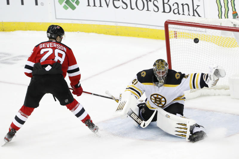 New Jersey Devils defenseman Damon Severson (28) gets his shot past Boston Bruins goaltender Jaroslav Halak (41) for a goal and the victory in a shootout in an NHL hockey game, Tuesday, Dec. 31, 2019, in Newark, N.J. The Devils defeated the Bruins 3-2 in the shootout on Severson's game-deciding goal. (AP Photo/Kathy Willens)
