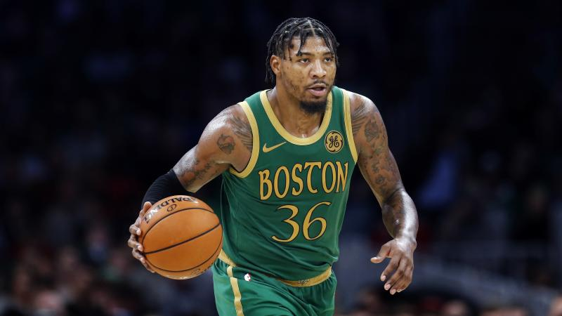 After taking a similar hit that caused him to tear his left oblique in April, Marcus Smart left Boston's win against the Knicks early on Sunday.