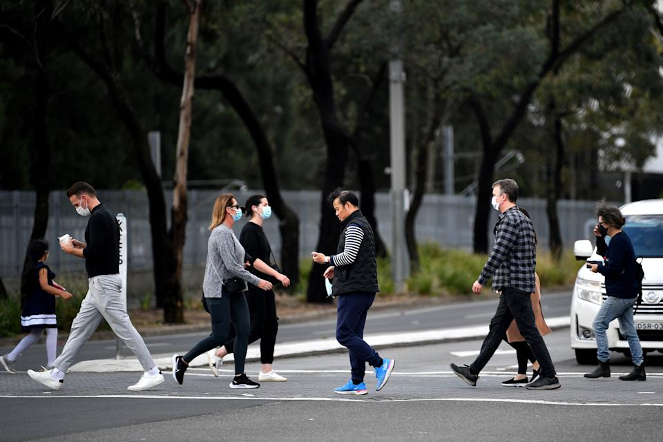 people walk towards a vaccination centre in Sydney