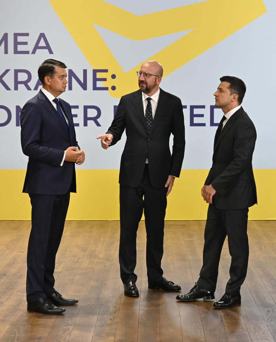 Ukrainian President Volodymyr Zelenskyy, right, European Council President Charles Michel, center, and Ukraine's parliament speaker Dmytro Razumkov talk during the Crimean Platform Summit in Kyiv, Ukraine, Monday, Aug. 23, 2021. The Crimean Platform, an international summit called by Ukraine to build up pressure on Russia over the annexation that has been denounced as illegal by most of the world, opened in Kyiv on Monday. (Ukrainian Presidential Press Office via AP)